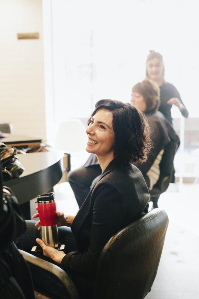 A client sitting in a hair salon chair.
