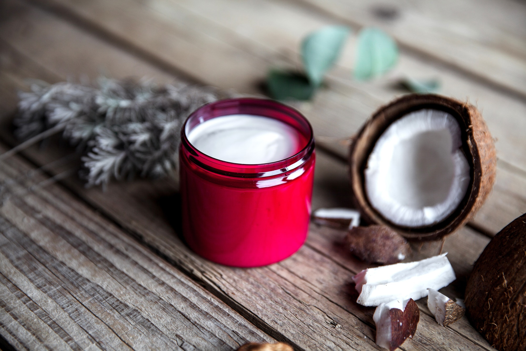 Organic cream on wooden background. Conditioner, shampoo for hair care. Natural cosmetics